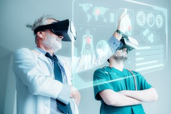 Physician Doctors Team are Using Virtual Reality Technology for Examining Physical Anatomy of Their Patient, Orthopedics Doctor Teamwork Diagnosing Anatomical Human Via VR Glasses. Virtual Innovation