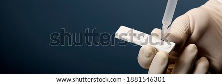 Physician who owns a COVID-19 antigen test kit with a COVID-19 2019-nCoV viral disease test kit. SARS-CoV-2 coronavirus virus lab card kit test. Rapid COVID-19 test Photo stock ©