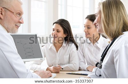 Physicians analyzing their work - stock photo