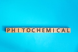 Phytochemical inscription wooden cubes with letters on a blue background