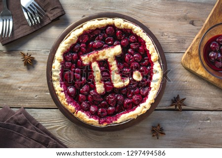 Pi Day Cherry Pie - Homemade Traditional Cherry Pie with Pi sign for March 14th holiday.