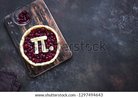 Pi Day Cherry Pie - making homemade traditional Cherry Pie with Pi sign for March 14th holiday, on rustic background, top view, copy space.