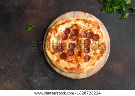 Pi Day Pizza. Homemade Pepperoni and Cheese Pizza for Pi Day Event, top view, copy space.