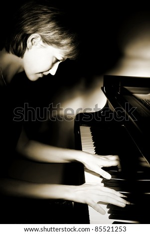 Pianist musician piano music playing. Musical instrument grand piano with beautiful woman performer.