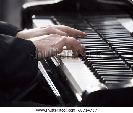 Pianist playing piano at event in memory of Frederic Chopin
