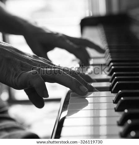 Pianist playing piano for learn melody music.
