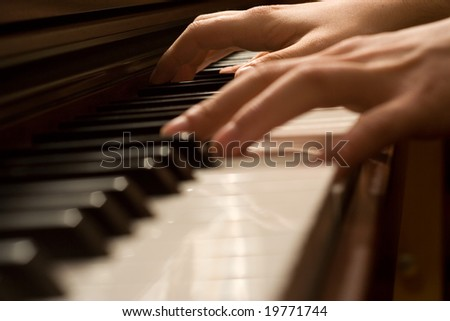 Pianists' hand playing the piano
