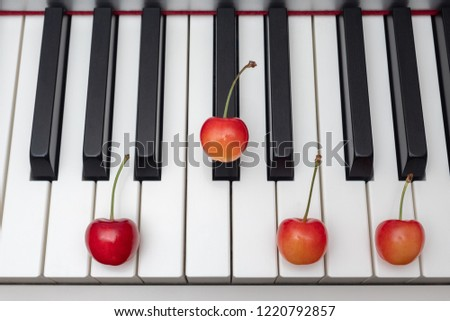 Piano chord shown by cherries on the key - Seventh series - A7 (A seventh)