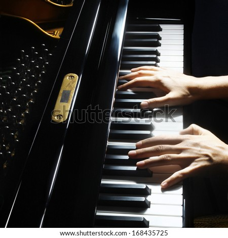 Piano hands pianist playing. Musical instrument grand piano playing details closeup