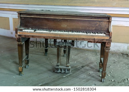 Piano in the Auditorium of an Abandoned School Building #1502818304