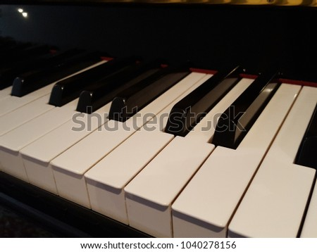 Piano keyboard background. Warm color toned image. Fair in blurred and de-focus, Soft focus,Select focus #1040278156