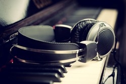 Piano keyboard with headphones for music