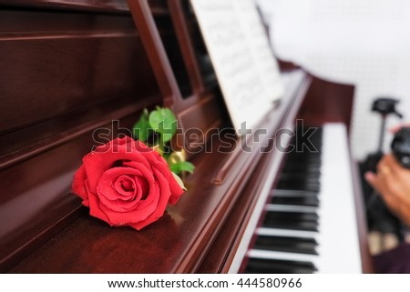 piano keys and red rose with copy-space,vintage effect.
