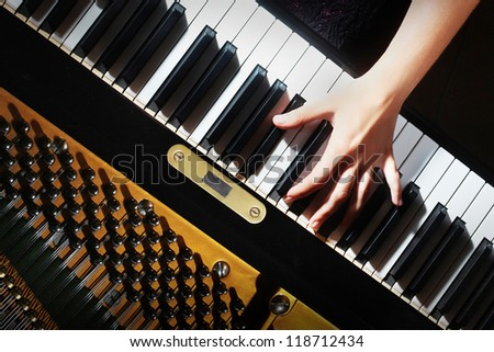 Piano keys pianist hands playing music. Musical instrument grand piano keyboard details