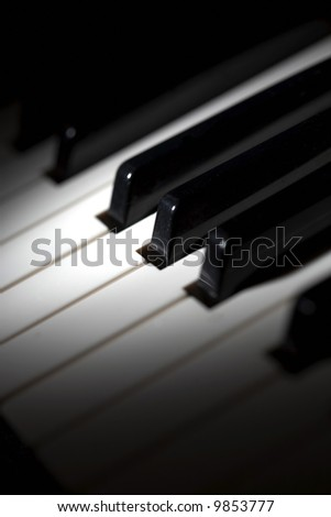 piano keys selective lighting - stock photo