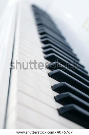 Piano keys side view - stock photo