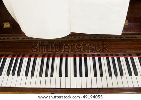 piano keys with blank/empty notes paper