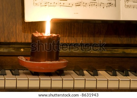 Piano, lyrics book and candle