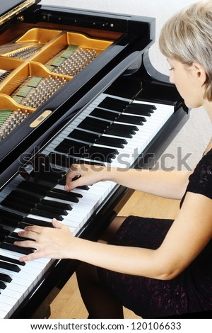 Piano music playing pianist musician. Musical instrument grand piano with beautiful woman performer