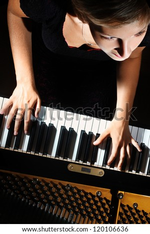 Piano music playing pianist musician. Musical instrument grand piano with beautiful woman performer. Focus is on the hands with instrument