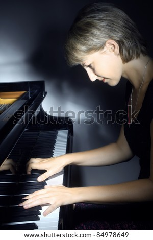Piano music playing pianist musician. Musical instrument grand piano with beautiful woman performer.