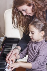Piano player and her student during lesson