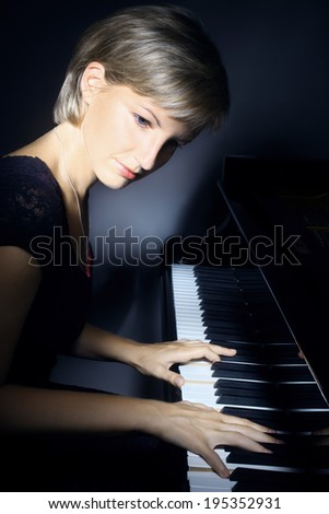 Piano player pianist playing. Musical instrument grand piano classical music concert