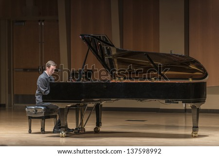 Piano Recital In A Concert Hall - A 20 Year Old Male Plays A Grand Piano