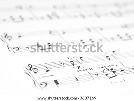 """Piano Sheet Music with words """"Sweetly, Softly"""" in Focus.  Shallow Depth of Field - stock photo"""