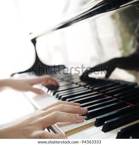 Piano with players hands