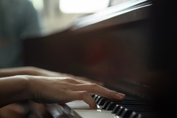 Piano with players hands,vintage and dark tone photo.