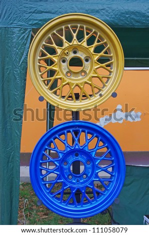 PIATRA NEAMT, ROMANIA - AUGUST 11: Two painted sport rims at Piatra Neamt Tuning Fest on August 11, 2012 in Piatra Neamt, Romania