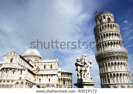 Piazza del Duomo (Piazza dei Miracoli) with famous landmarks of Pisa - Duomo cathedral, cherubs statue and leaning tower. It is UNESCO World Heritage Site.