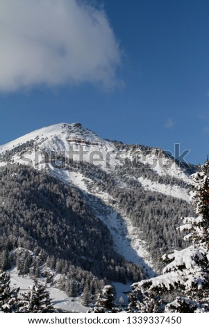 Pic covered in Snow. Mountain in the Dolomites in Val Gardena seen from La Selva in Wolkenstein in Gröden. Winter Landscape