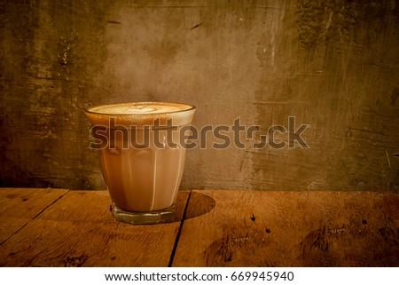 Piccolo Latte Coffee on warm light  #669945940