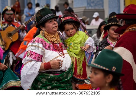 PICHINCHA, ECUADOR - JUNE 30, 2011: Unidentified indigenous woman with her child at Inti Raymi indigenous celebration in Cayambe, Ecuador