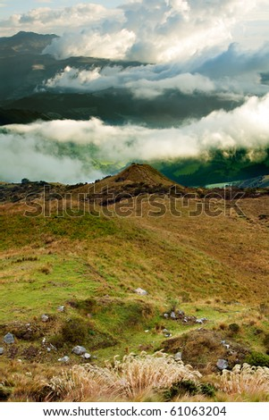 PICHINCHA VOLCANO COVERED WITH HEAVY CLOUDS IN NEARBY OF QUITO, ECUADOR