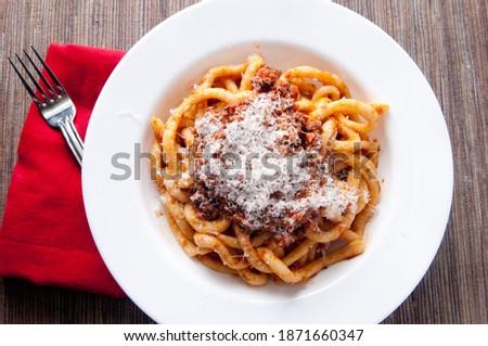 pici pasta with lamb ragu and parmesan cheese Stock fotó ©