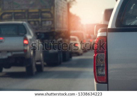 Pick up car on the road in traffic junction there are many cars on the road. #1338634223