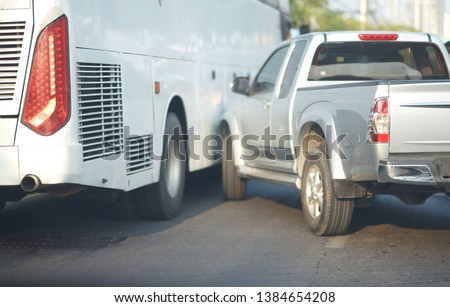 Pick-up truck bump Bus by accident on traffic jam #1384654208