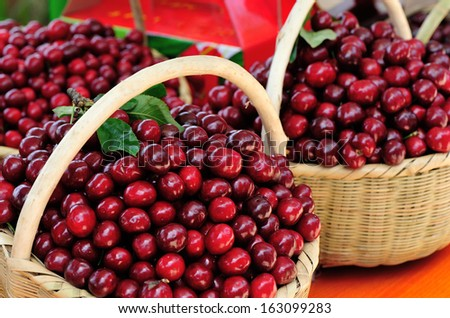 picked fresh red cherry fruits  in bamboo basket