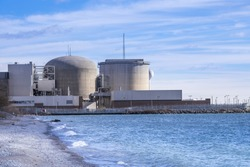 Pickering Nuclear Generating Plant, as seen from the shore of Lake Ontario, is located in  Pickering a city just outside of Toronto Canada.
