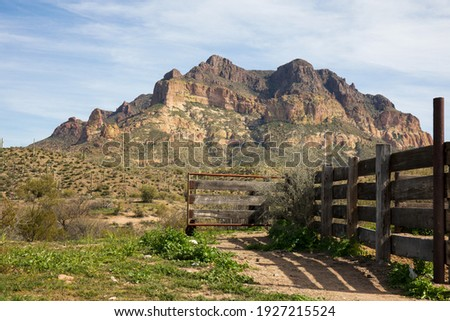 Picket Post Mountain in Arizona with a corral and desert wash in the foreground.  Also known for the site of Apache Leap and the natural obsidian deposits known as Apache Tears.