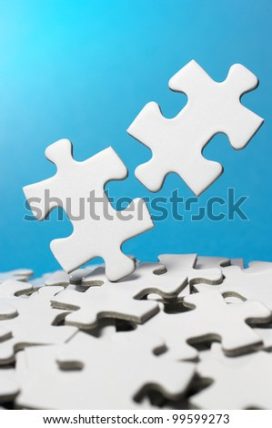 Picking out two fitting puzzle pieces.(vertical)