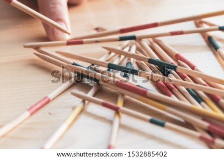 Picking up a wood pick-up stick from a random pile in Mikado game Photo stock ©