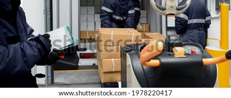 Picking up package boxes in the loading area of cold storage warehouse prepare to transfer storage in freezing room with note. Storage Warehouse Service in Logistics Business concept in Banner size.