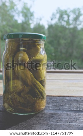 pickled cucumbers in jar #1147751999