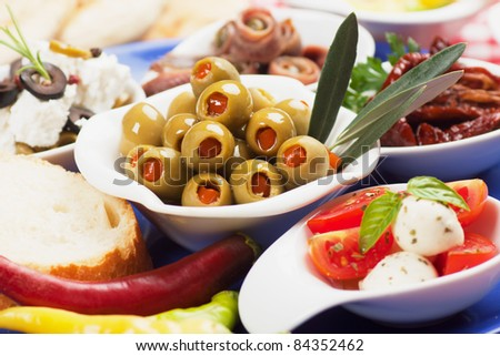 Pickled greed olives with other mediterranean appetizers and snacks