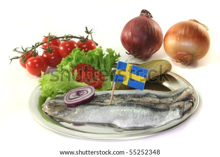 pickled herring with onions, tomato, cucumber and lettuce