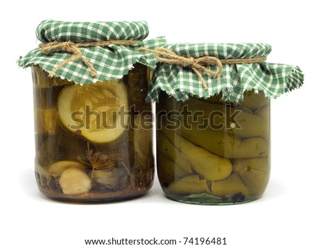 Pickled paprika and cucumber on white background